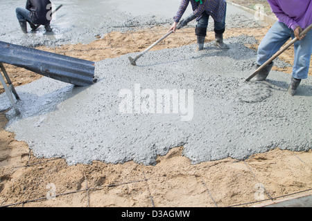 Concrete pouring during commercial concreting floors of buildings in construction - Stock Photo