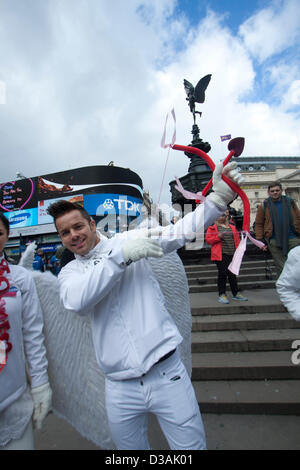 14th February 2013. Piccadilly, London, UK. A man dressed as cupid Eros the God of Passionate love in Greek mythology - Stock Photo