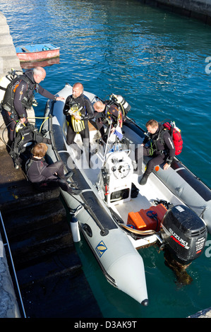 Divers getting ready to go on a dive leaving the harbour in a rib, semi rigid inflatable boat, Playa San Juan, Tenerife, - Stock Photo