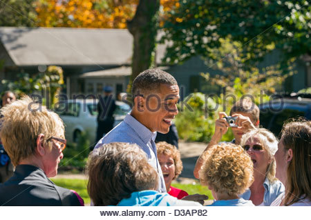President Barack Obama greets supporters in a Des Moines, Iowa neighborhood during a back yard speech in 2010. - Stock Photo