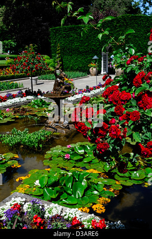 Italian Garden section area Butchart Gardens Brentwood Bay Victoria British Columbia Canada rose basket lily pond - Stock Photo