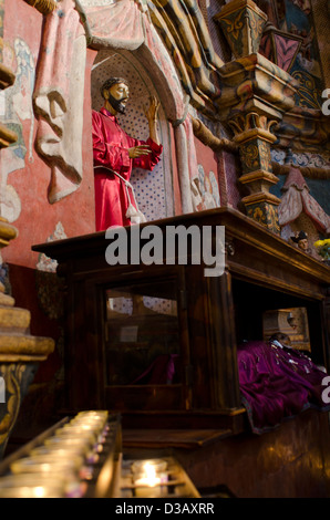 Here a statue of San Xavier lies in state where pilgrims who pray for healing pin a milagro on his blanket at San - Stock Photo