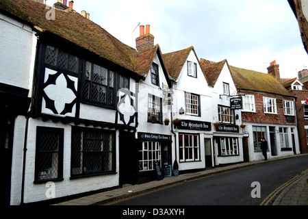 The Mint, an extension of Rye High Street in East Sussex is lined with early medieval, black and white, half-timbered - Stock Photo
