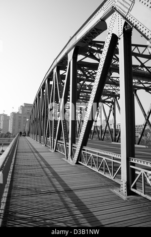 Black and white scenery of an old steel bridge for pedestrian and vehicle. - Stock Photo
