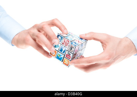 A hands holding rubik's cube with logotypes of well-known social media brand's. - Stock Photo