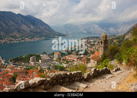 Panoramic view of the Kotor bay and the town in a bright sunny day. High angle shot from the fortress above the - Stock Photo