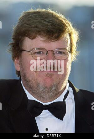(dpa) - US director Michael Moore, pictured at the 55th International Film Festival in Cannes, France, 26 May 2002. - Stock Photo