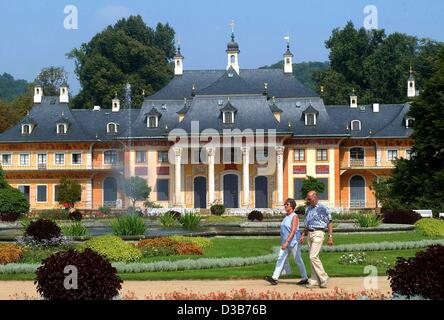 (dpa files) - Visitors take a walk in the gardens of Pillnitz Castle in front of the Bergpalais (mountain palace) - Stock Photo