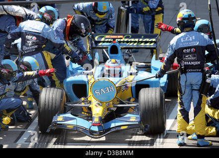 Spanish Formula One driver Fernando Alonso of Renault in pit stop during British Formula One Grand Prix at the race - Stock Photo