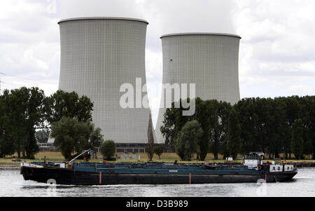 (dpa)  - A river cargo ship on river Rhine passes the nuclear power plant in Biblis, Germany, 05 July 2005. For - Stock Photo