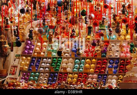 (dpa) - Christmas decorations are on display at a stand on the famous 'Christkindlesmarkt' (christmas market) in - Stock Photo