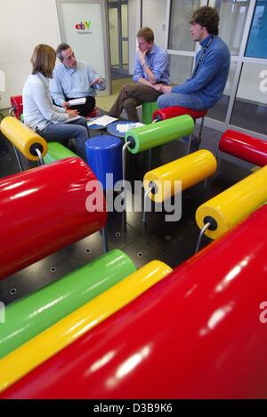 (dpa) - Four employees of the online auction service 'ebay Deutschland', talk during a meeting in the 'Playstation' - Stock Photo