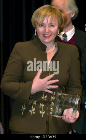 (dpa) - Lyudmila Putina, the wife of Russian President Vladimir Putin, holds in her hands the Jacob-Grimm-Prize - Stock Photo
