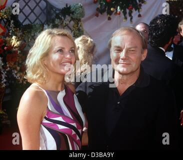 (dpa files) - Austrian actor Klaus Maria Brandauer poses with his girlfriend Uta Gruenberger ahead of the Emmy Awards - Stock Photo