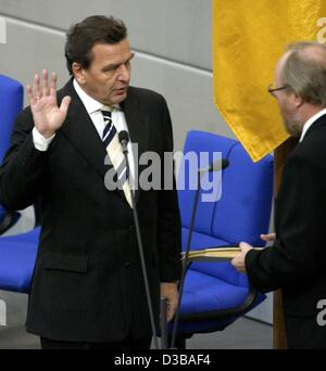 (dpa) - Reelected German Chancellor Gerhard Schroeder (L) is sworn in by Wolfgang Thierse, President of the Bundestag, - Stock Photo