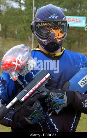 (dpa) - A paintball player was hit by a colour bullet during a paintball competition in a forest near Frankfurt - Stock Photo