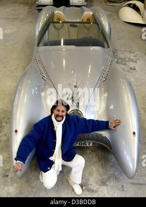 (dpa) - Industrial designer Luigi Colani is proudly posing with a Horch Colani C1 car (500 hp, V8) in his workshop - Stock Photo