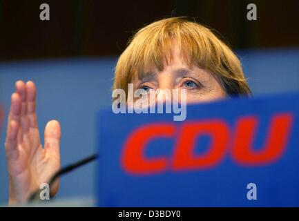 (dpa) - Angela Merkel, Chairwoman of the CDU party, gives a speech in the election campaign for the upcoming regional elections in the German state Lower Saxony, Osnabrueck, Germany, 23 January 2003. Merkel accuses Chancellor Schroeder of not taking the work of weapon inspectors of the United Nation