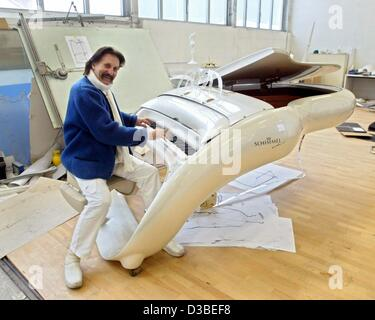 (dpa) - Industrial designer Luigi Colani is posing with a grand piano in his workshop in Karlsruhe, Germany, 13 - Stock Photo