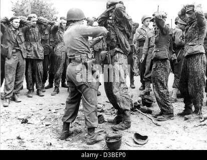 (dpa files) - German soldiers are frisked as they are captured near Gavray, France, 10 February 1945. - Stock Photo