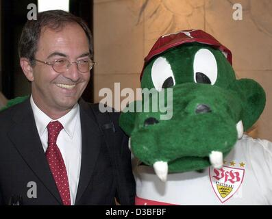 (dpa) - Erwin Staudt, the new President of the German soccer club VfB Stuttgart, poses next to the club's mascot - Stock Photo