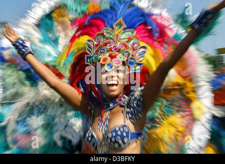 (dpa) - A Brazilian woman with feathered headdress dances through the streets during the Carnival of Cultures parade - Stock Photo