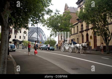Macquarie Street close to the Sydney Harbor Bridge, Sydney Australia - Stock Photo