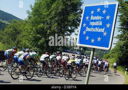 (dpa) - The cyclist ride on their bicylces across the border between Austria and Germany in the 7th leg of the Tour - Stock Photo