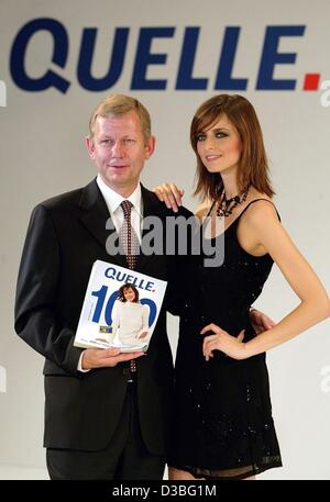 (dpa) - Christoph Achenbach (L), Chairman of Quelle AG, stands with 23-year-old fashion model Eva Padberg on the - Stock Photo