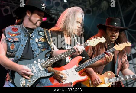 (dpa) -  The three guitarists of the US rock band Lynyrd Skynyrd, (from L)  Hughey Thomasson, Ricky Medlocke and - Stock Photo