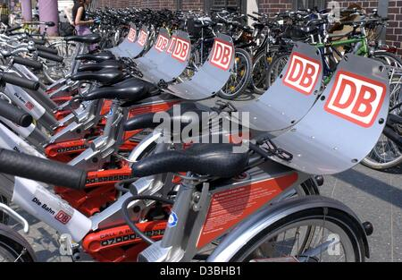 (dpa) - A row of rental bicycles of the German railway company Deutsche Bahn (DB) stand at a bicycle stand in Berlin, - Stock Photo