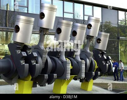 (dpa) - Oversize pistons for a car engine stand like a sculpture in front of a building of the car parts manufacturer - Stock Photo