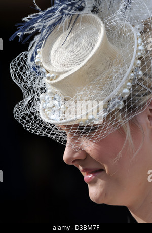 A woman arrives for Ladies Day at the Cheltenham Festival an annual horse racing event. - Stock Photo