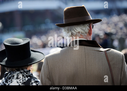 People watch the racing during the Cheltenham Festival, an annual horse racing fixture in southwest England - Stock Photo