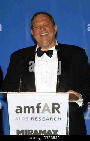 (dpa) - Hollywood producer Harvey Weinstein, Chairman of the film company Miramax, speaks during the auction at - Stock Photo