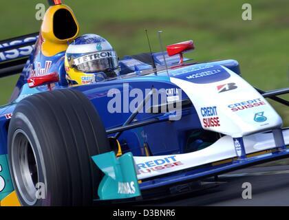 (dpa) - German formula one pilot Nick Heidfeld of the Sauber-Petronas team races his bolide during the qualifying - Stock Photo