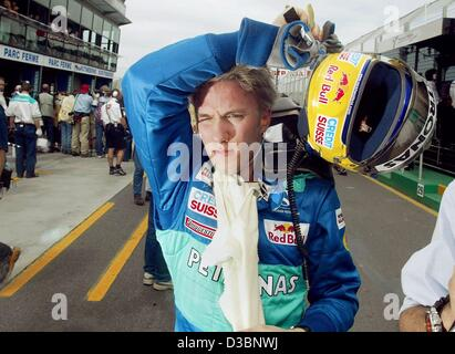 (dpa) - German formula one pilot Nick Heidfeld of the Sauber team takes off his helmet after the first qualifying - Stock Photo