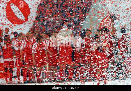 (dpa) - The players of the soccer club Bayern Munich celebrate with the Bundesliga trophy (C) in the Olympic Stadium - Stock Photo