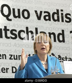 (dpa) - Angela Merkel, leader of the CDU, stands behind a lectern, during her speech at the Konrad-Adenauer Foundation in Berlin 1 October 2003.  The slogan on the poster behind her reads 'Quo Vadis' (where are we going?). Merkel spoke on the occasion of the 13th anniversary of the German Unificatio