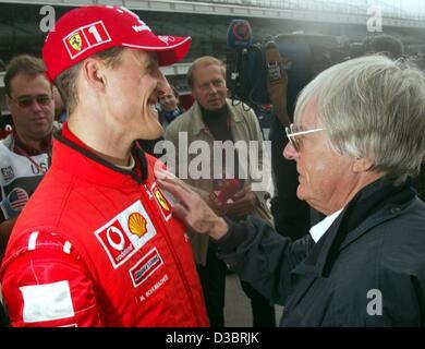 (dpa) - British head of the formula one racing federation Bernie Ecclestone (R) and German formula one world champion - Stock Photo