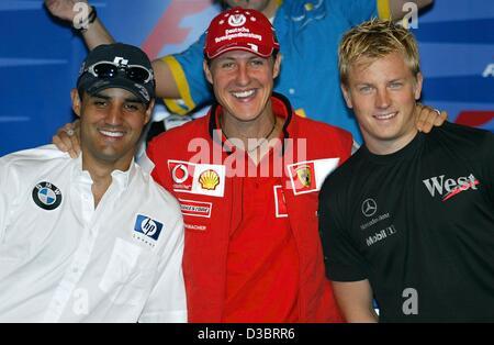 (dpa) - The formula one pilots (from L:) Juan Pablo Montoya of BMW-Williams, Kimi Raeikkoenen of Mercedes-McLaren - Stock Photo