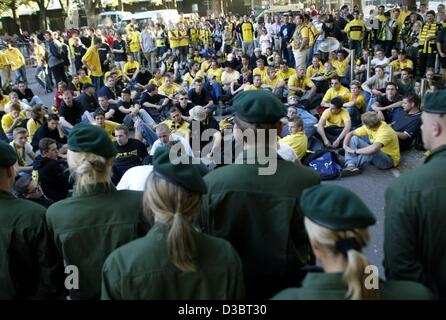 (dpa) - Disappointed fans of the soccer club Borussia Dortmund have a sit in to block the entrance of the stadium - Stock Photo