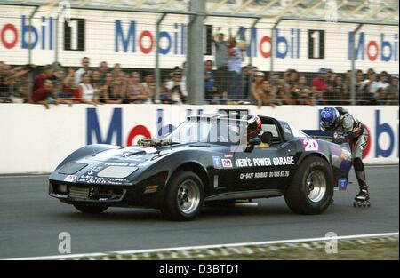 (dpa) - The Swiss stuntman Juerg Schlaeffi stands on inline skates and holds on to a 1000 hp strong Drag Race Corvette, - Stock Photo