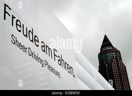 (dpa) - A bilingual BMW advertisement for the international auto show IAA is seen in front of the trade fair tower - Stock Photo
