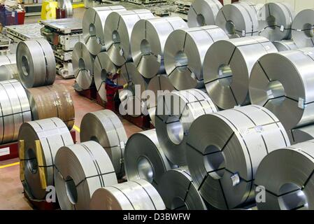 (dpa) - A worker measures the radius of a coil at the Tailoured Blanks factory of ThyssenKrupp steel in Duisburg, - Stock Photo