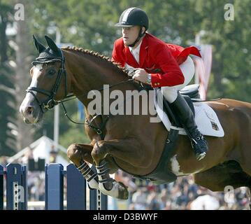 (dpa) - German jumping rider Marcus Ehning clears an obstacle on his horse Four Pleasure during the first competition - Stock Photo