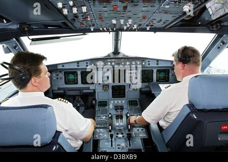 (dpa) - Two pilots of the German airline LTU sit in the cockpit of an Airbus A 321-200 in Hamburg, Germany, 11 July - Stock Photo