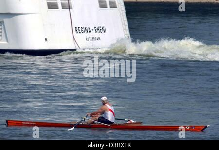 (dpa) - A rower passes a vessel on the River Rhine near Cologne, Germany, 5 August 2003. - Stock Photo