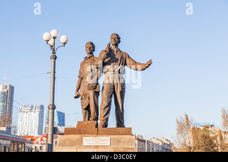 Socialist realist statues on the Green Bridge, Vilnius, Lithuania - Industry and Construction, under a blue sky - Stock Photo