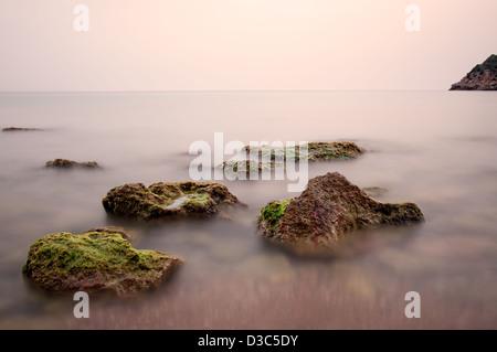 Stones in Sa Caleta beach. Ibiza, Balearic Islands, Spain - Stock Photo